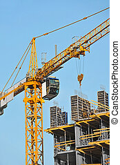 Crane and construction site - Crane and building ...