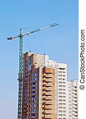 Crane and highrise construction sit