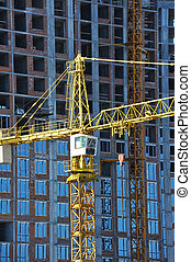 Crane and building from concrete and brick