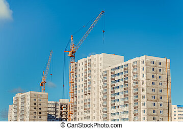 Crane and new residential high-rise buildings