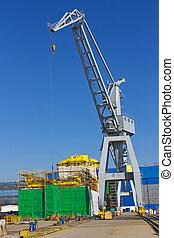 Crane and ship under construction at the shipyard