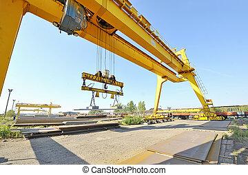 crane and steel plates
