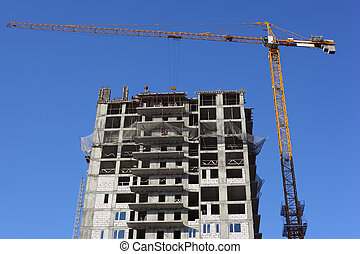 crane and under construction building