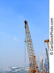 crane arm against a city background