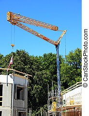 Crane at construction site with blue sky