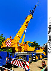 Crane - Big and yellow construction crane for heavy lifting...
