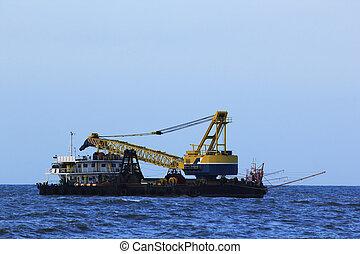 Crane boat in the sea