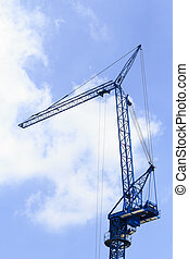 Crane boom on industrial site. against a clear blue sky