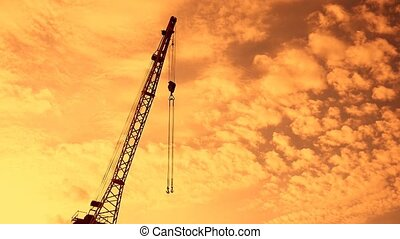 crane boom with hook silhouette at sunset video - crane boom...