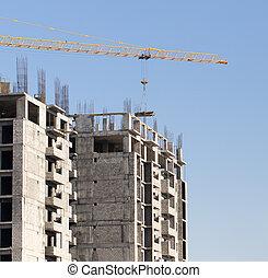Crane building a multi-storey building
