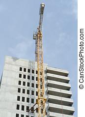 Crane by building - Building under construction