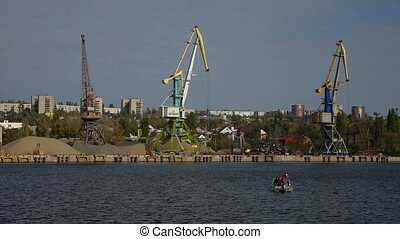 crane cargo in the river small ship port view from sea to...