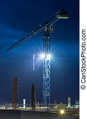 Crane. Construction. Night sky. - Tall lifting crane and...