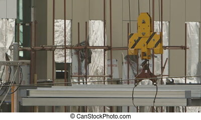 Crane Hoist and Building Framework - Steady, medium close up...