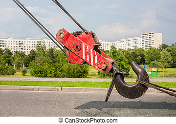 crane hook against city area - truck crane hook against the...