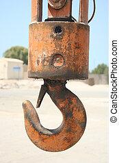 Crane Hook - an orange rusty crane hook