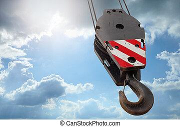 Crane hook on a blue sky