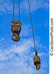 Crane hook on blue sky background