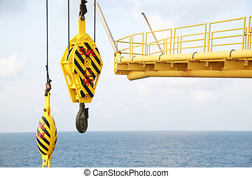 Crane hooks on work site, Crane on Oil and gas platform for ...