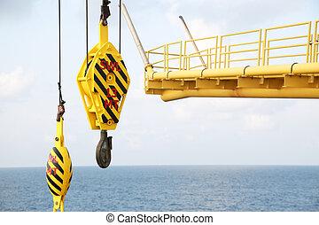 Crane hooks on work site