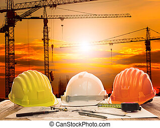 crane in construction site and working table of civil engineer w