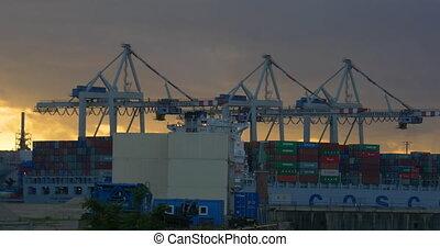 Crane in harbor, loading ships