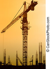 Crane in sunset at building site