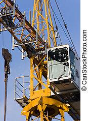Crane in the blue - A construction site crane in a blue sky.