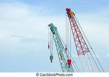 Crane lift green and red In the blue sky