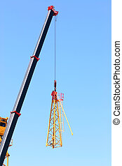 Crane lifting pieces of equipment
