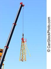 Crane lifting pieces of equipment