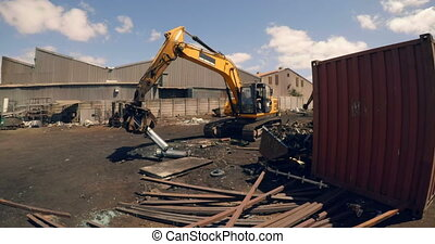 Crane lifting scrap in scrapyard 4k - Crane lifting scrap in...