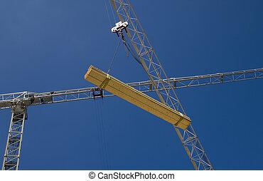 Crane lifting timber