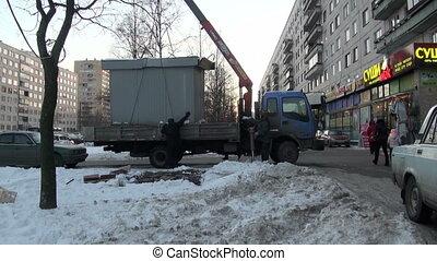 Crane lifts stall