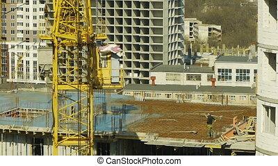 Crane lifts the concrete on the construction floor