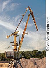 Crane loading cargo in the river port