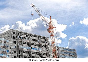 crane near building on Cloudy sky background