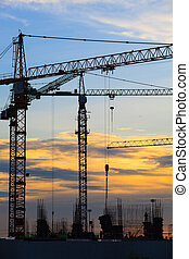 crane of building construction against beautiful dusky sky