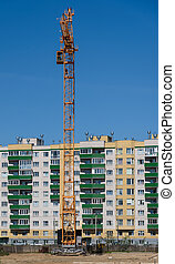 crane on background of a new home and blue sky