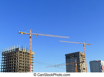 crane on the background of beautiful blue sky with clouds.