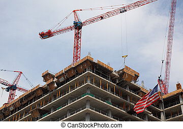 building a office highrise tower - crane on top of...