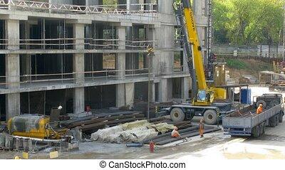 Crane operates at construction site at Losiniy Ostrov estate