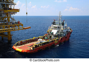 Crane operation on offshore construction platform.Cargo...