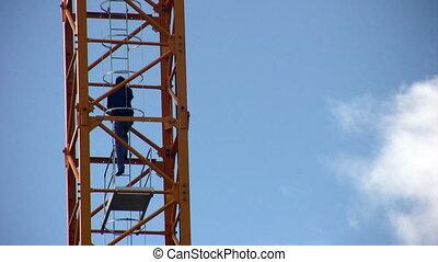 crane-operator rises on crane