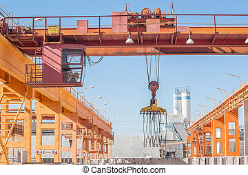 Crane operator working at finished goods warehouse