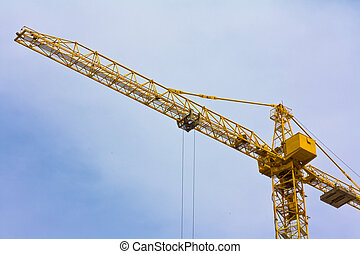 Crane over blue sky with clouds