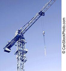 Crane - Part of a crane against blue sky. Close up.