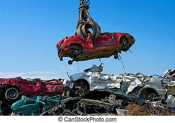 Crane picking up car - Crane picking up a car in a junkyard