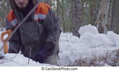 Ecologist in the forest digging a soil slit - Crane shot....