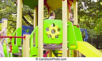 Three girls on a play complex on the playground - Crane...